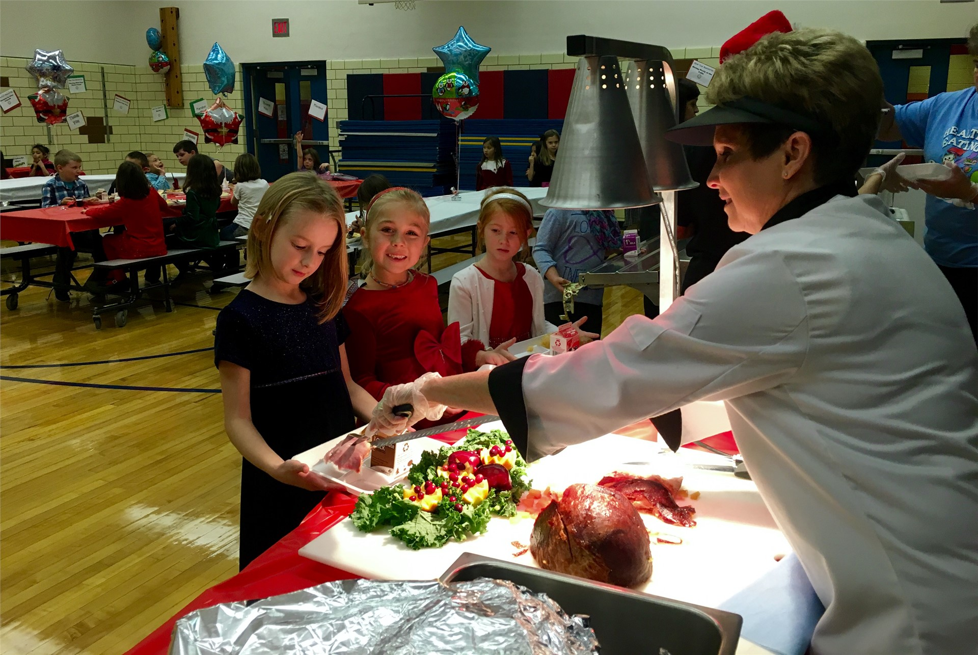 Students enjoy the holiday carving lunch.