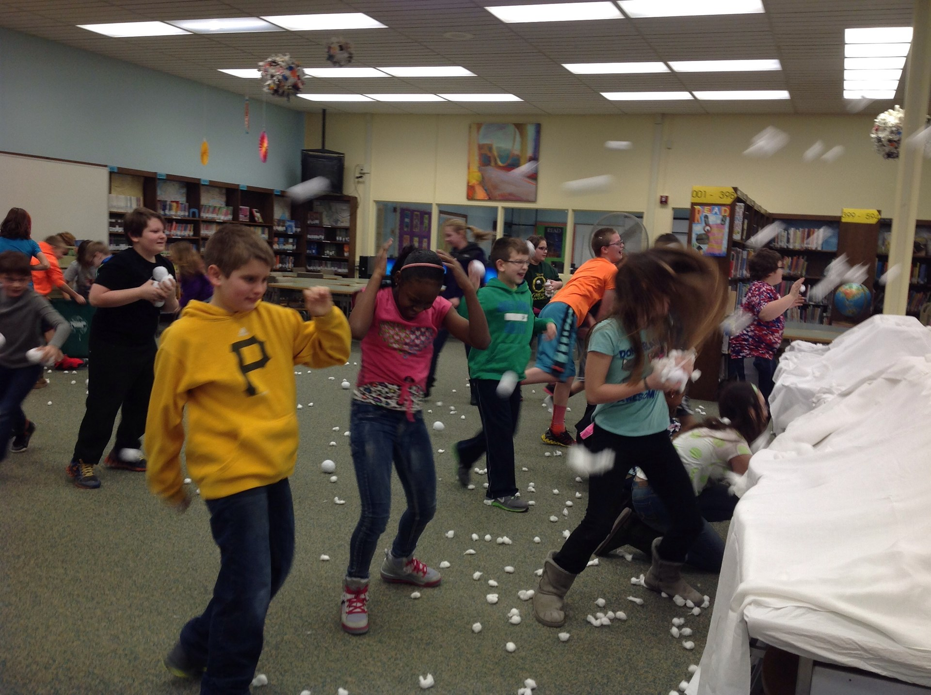 "House C celebrates having read more words than any other team with, of course, a ""snowball fight"" in the library."