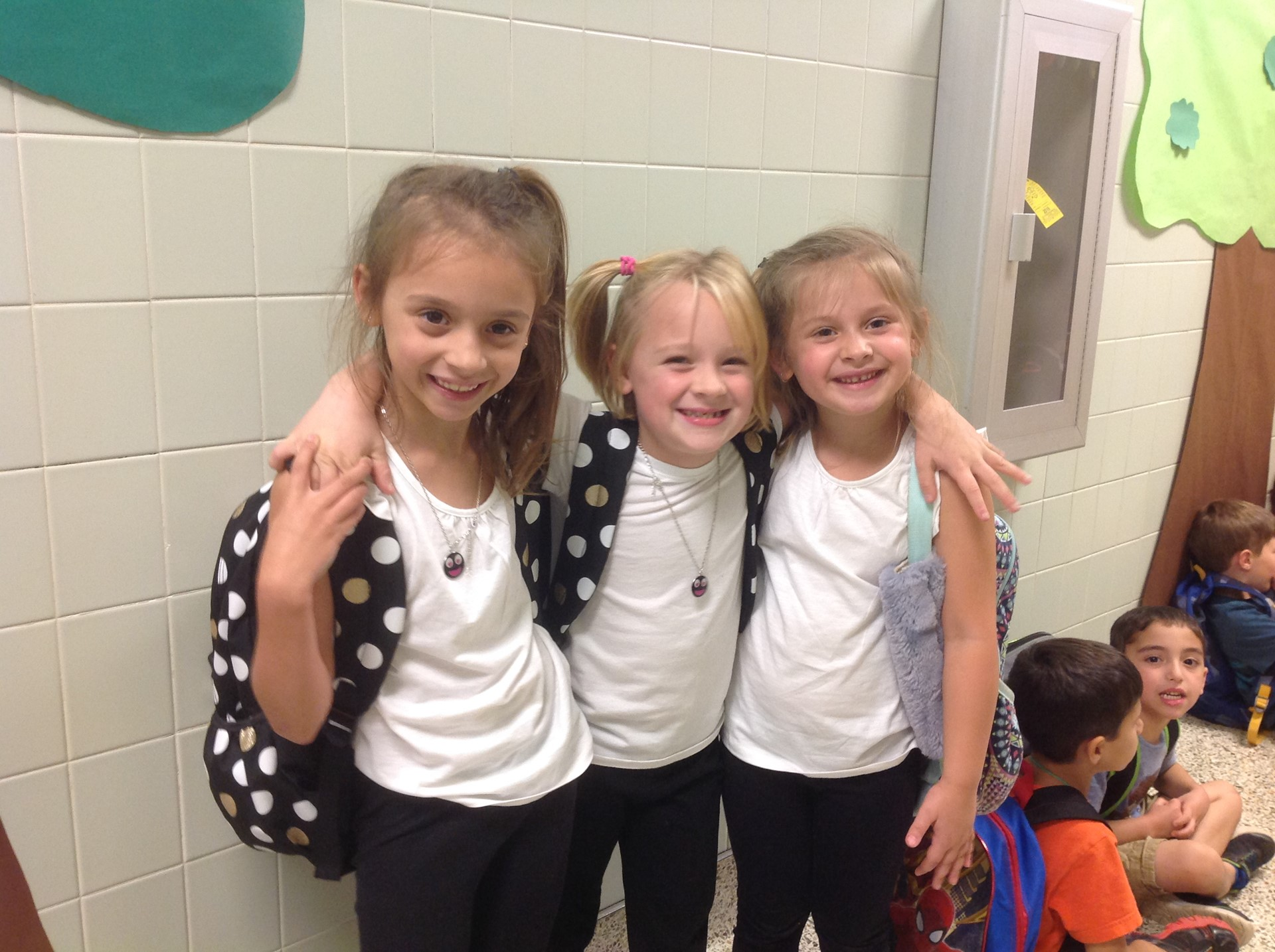 "A trio of friends dressing for ""Twins Day"""