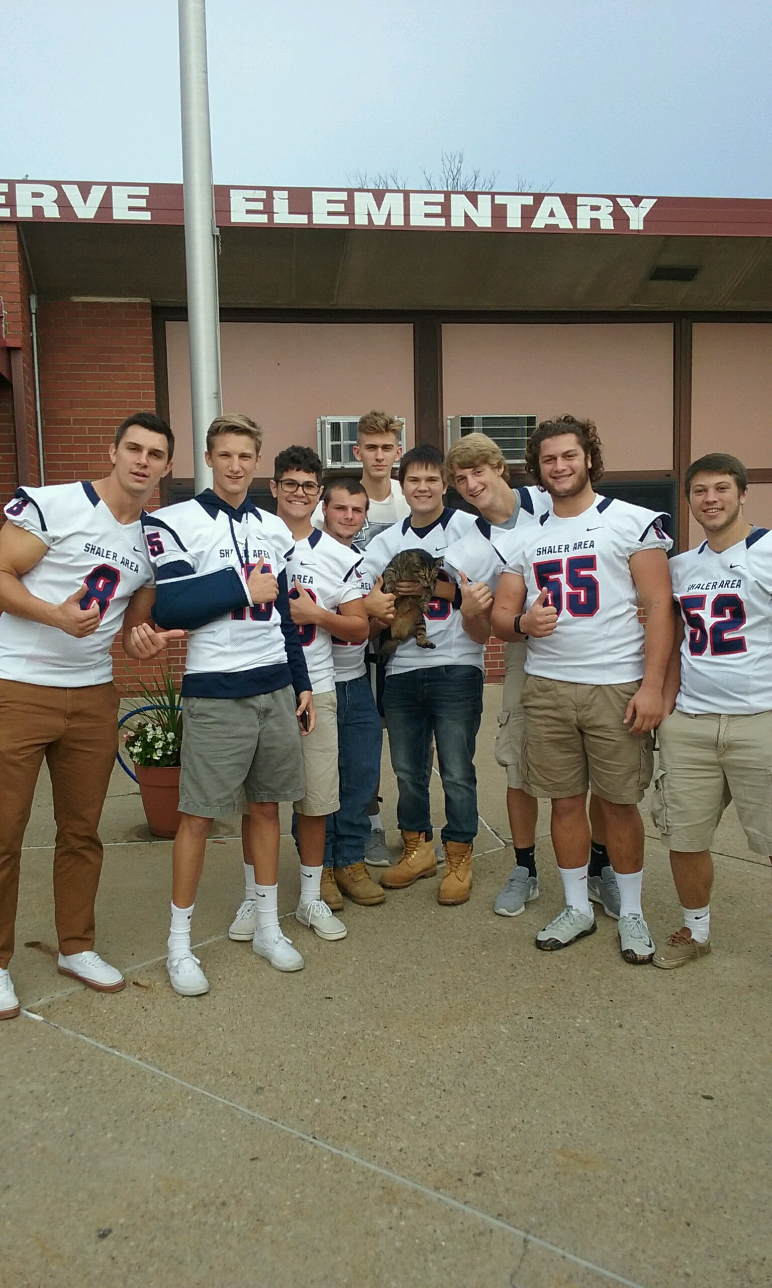 Pep Rally - Football Players with local Cat