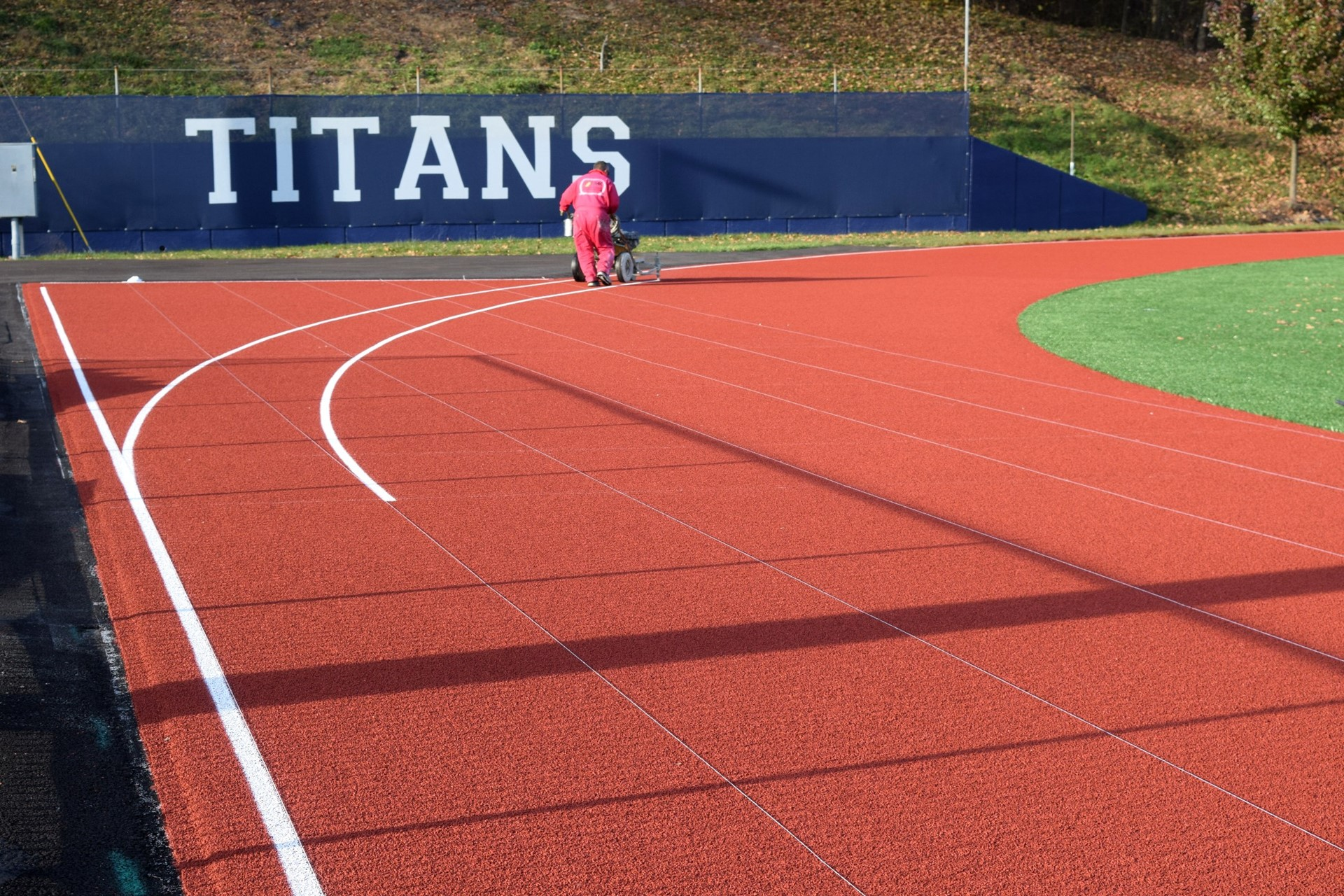 Lines being painted on the track surface