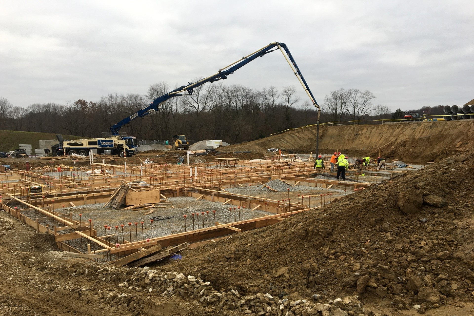 Pouring concrete at the new school construction site