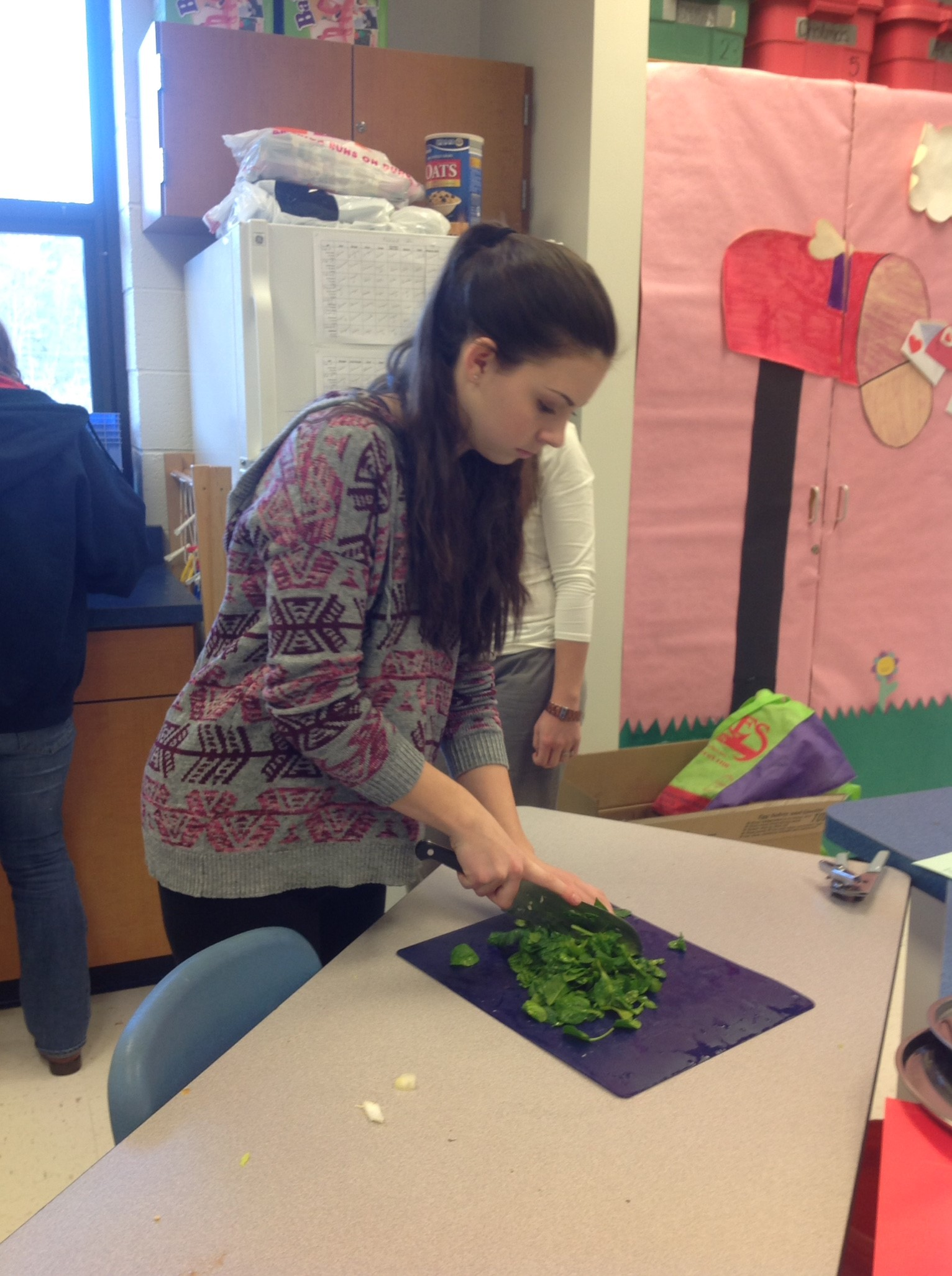 Making vegetable soup for the Preschool students