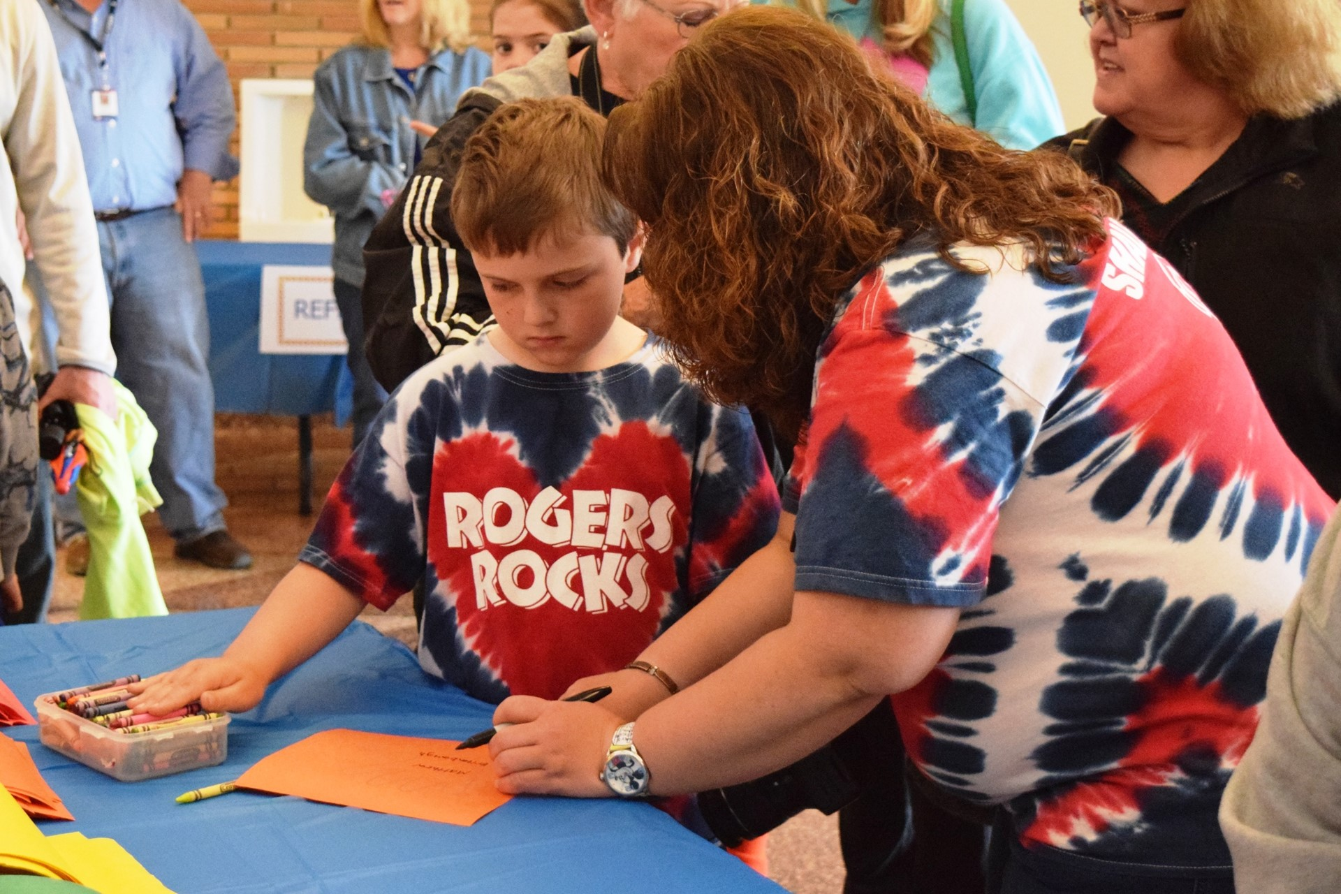 Creating handprint memory art during the Rogers Reunion: May 2016