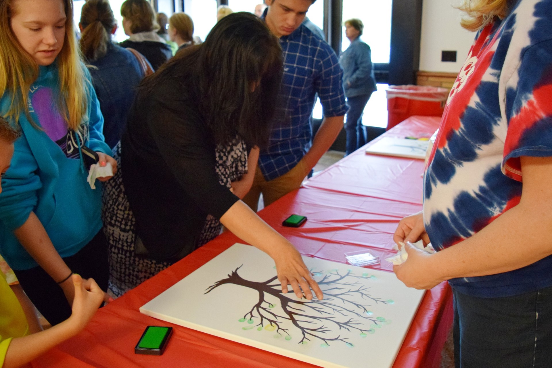 Creating thumbprint art during the Rogers Reunion: May 2016