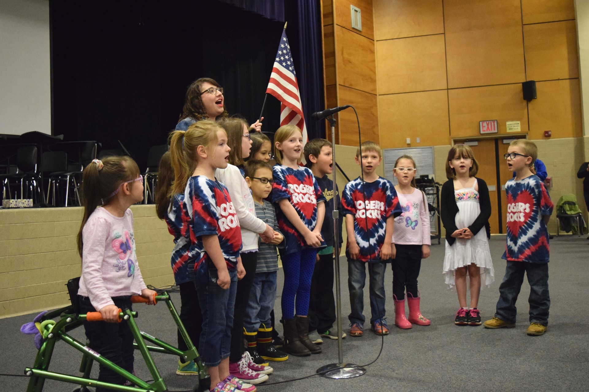 Rogers 1st-graders sing the National Anthem during the Rogers Reunion: May 2016