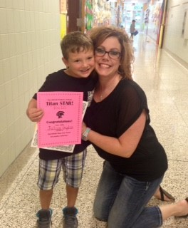 Mrs. Franz congrats her student of his first STAR