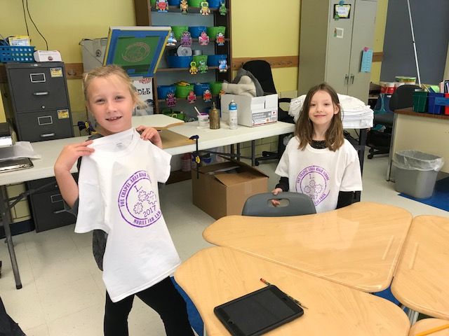 Mobile Fab Lab 2nd Grade students working with printing shirts