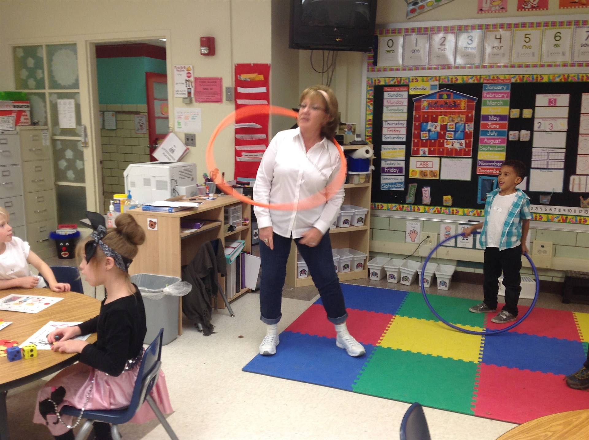 Hula Hoop skills during Kdg. 50th Day Celebration