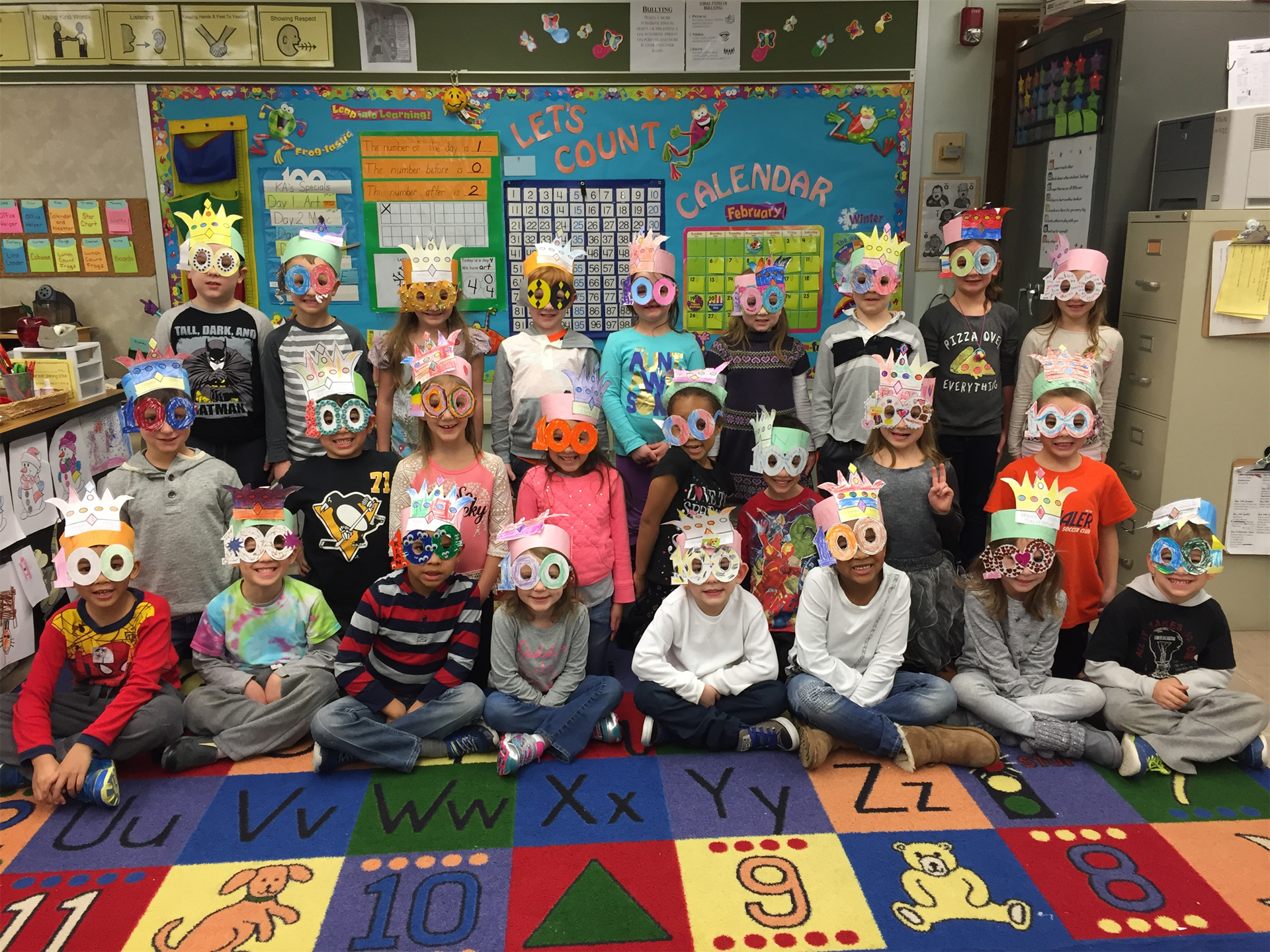 students in classroom wearing 100 day glasses