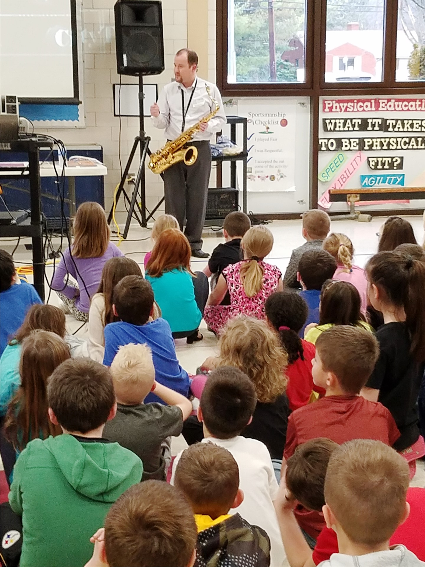 Mr. Dunlevy teaches 2nd and 3rd grade about instruments