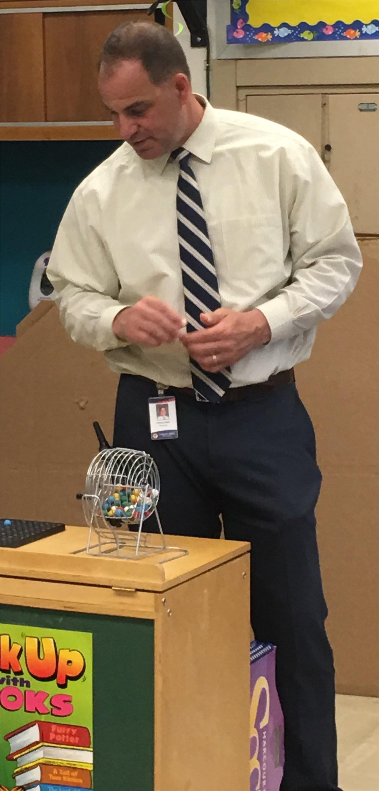 Mr. Rojik calls bingo during the end-of-year celebration