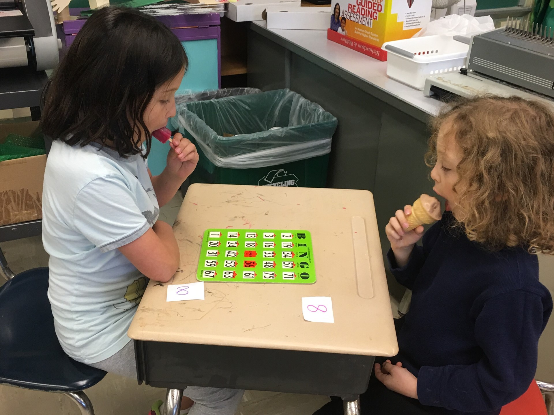 Students enjoy bingo and frozen treats during the end-of-year celebration