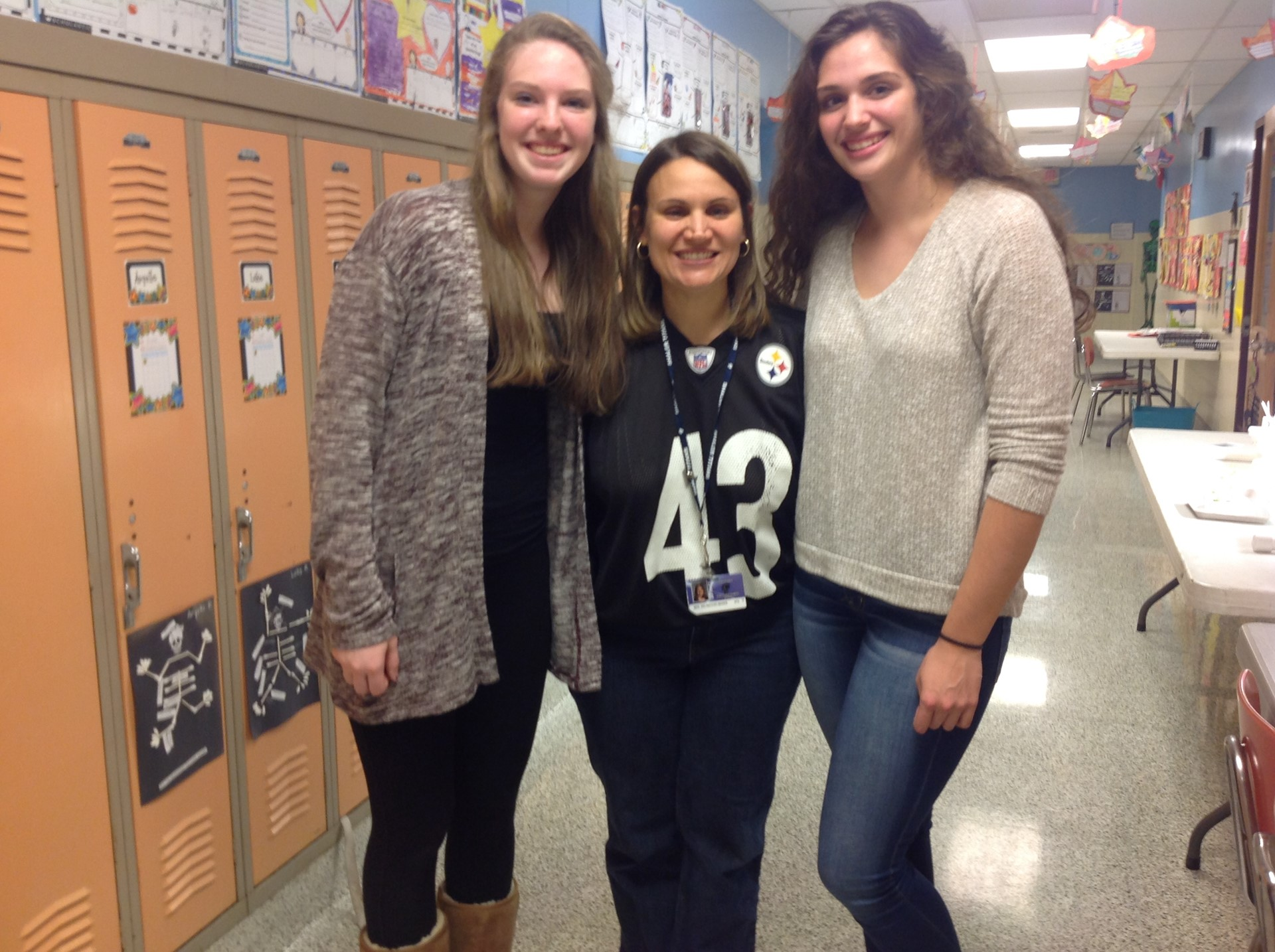 Mrs. DM poses with Shaler Area High School students who presented information to 3rd grade students