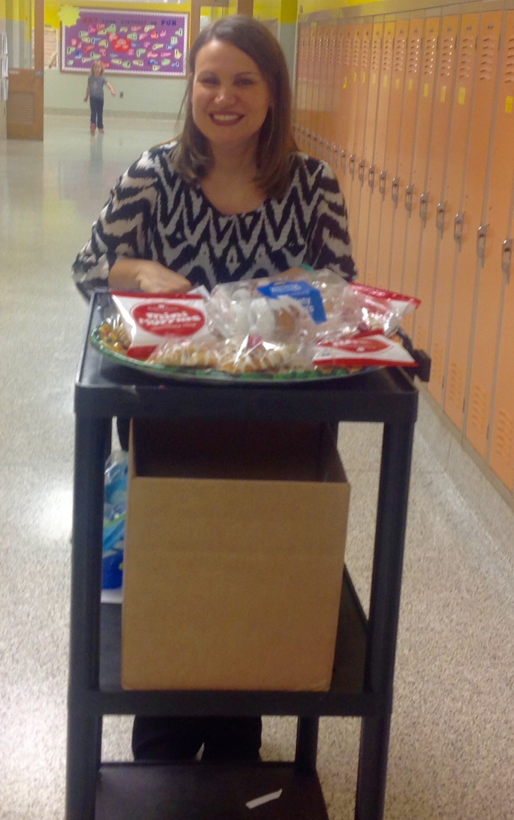 Mrs. DM delivers waters and snacks to JA Day presenters