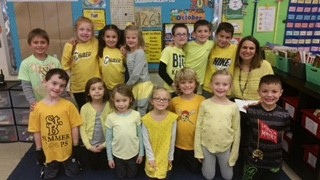 "Mrs. DM &  students wear yellow to show that the ""future is bright"""