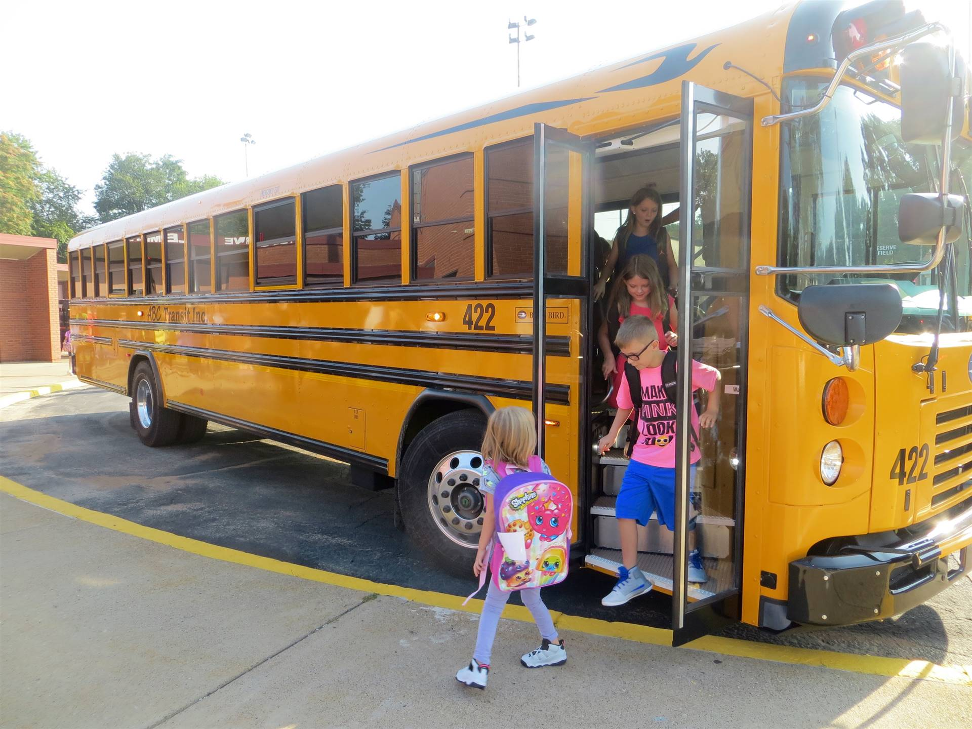 First Day of School, students arriving on the bus.