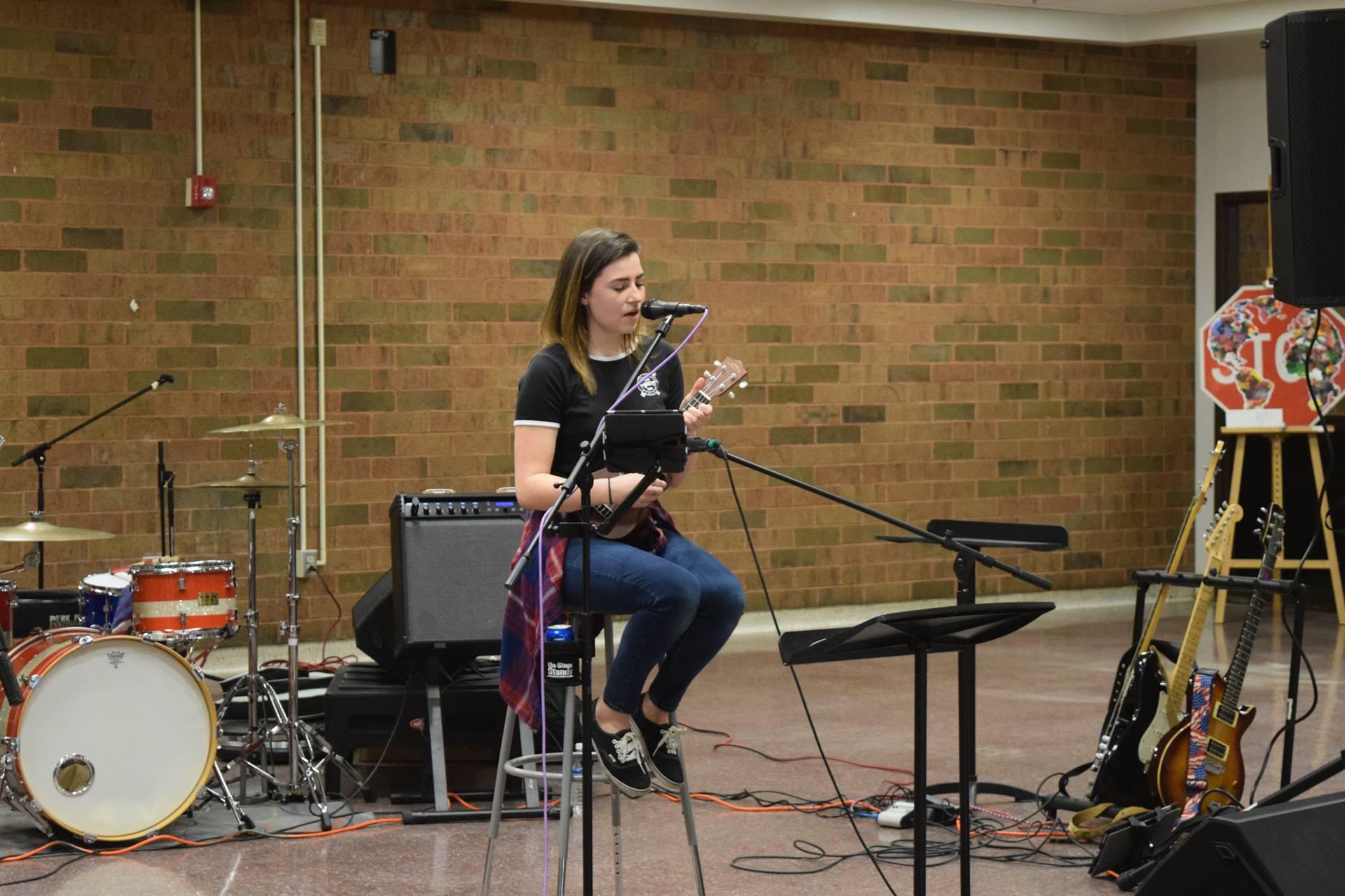 female student solo performance with a ukulele