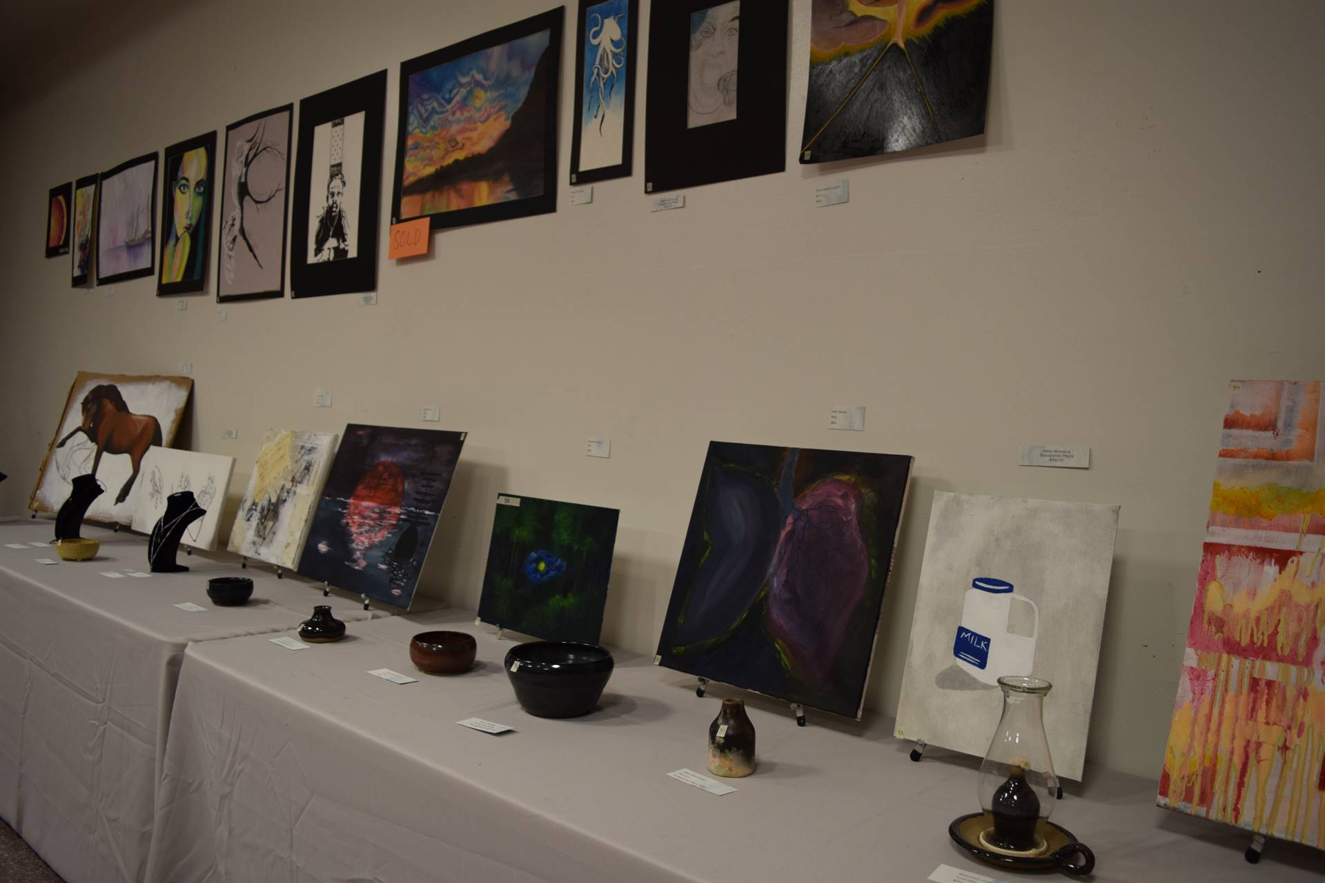 student paintings and drawings on display