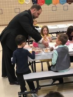 Mr.-Rojik-teaching-kindergarten-how-to-cut-food-properly