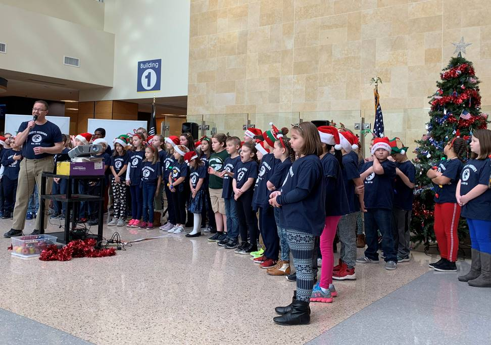 Students spread holiday cheer at the VA with music