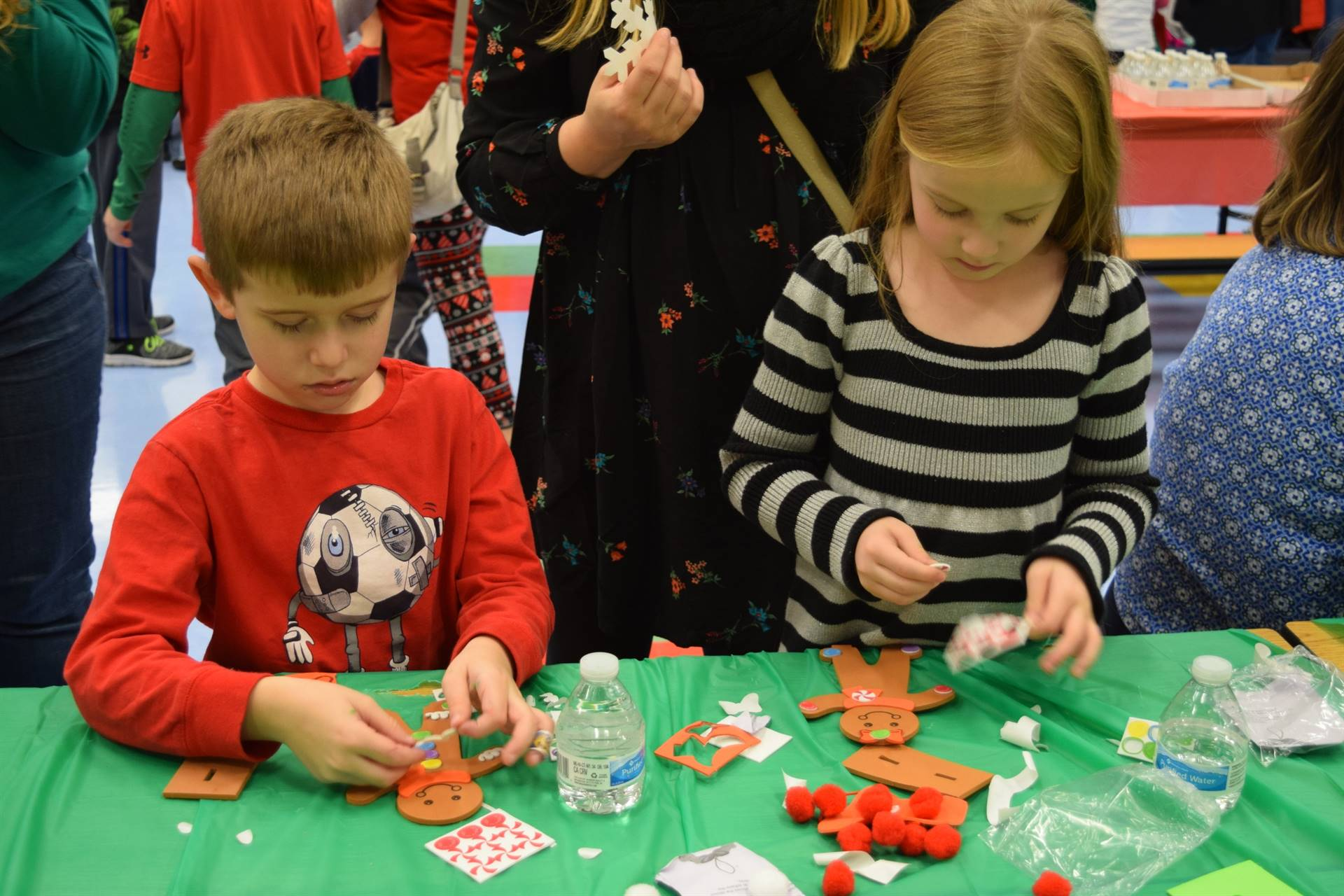 Boy and girl making gingerbread ornaments