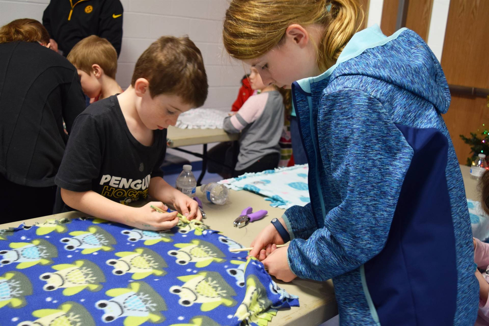 Students making blankets for Project Linus