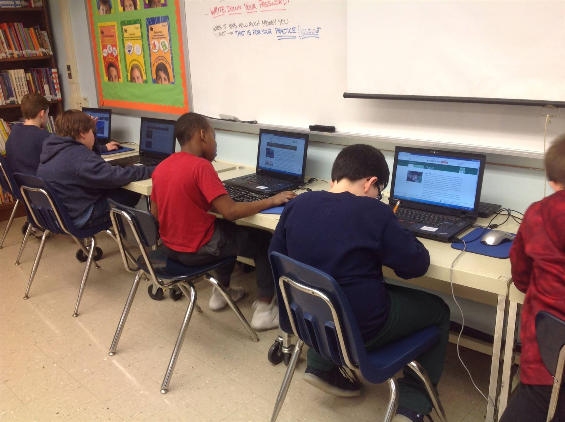 a group of boys using computers