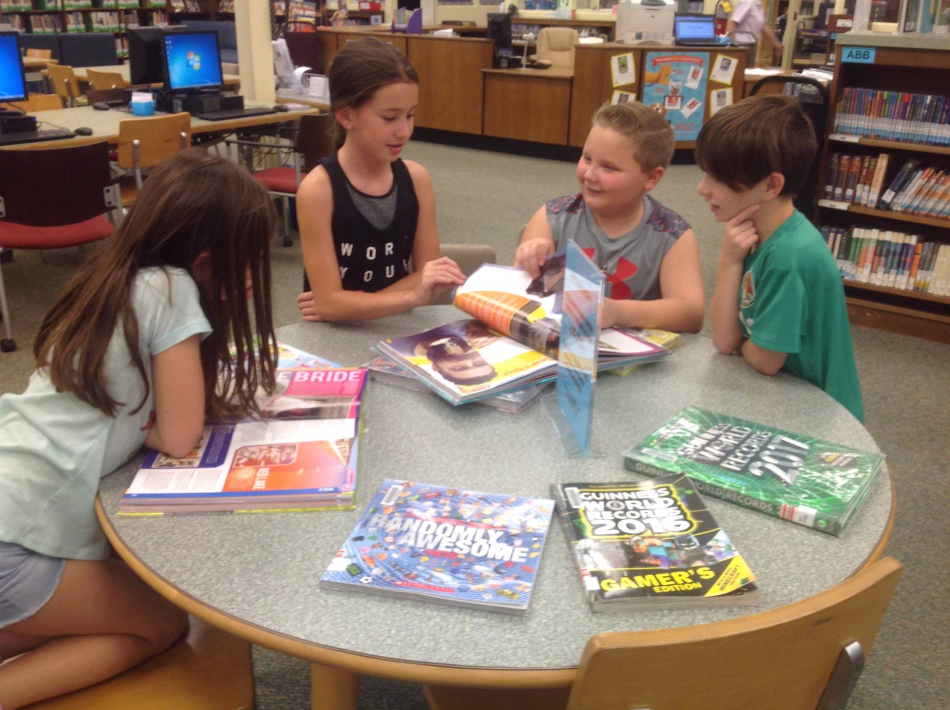 a small group using books to share facts