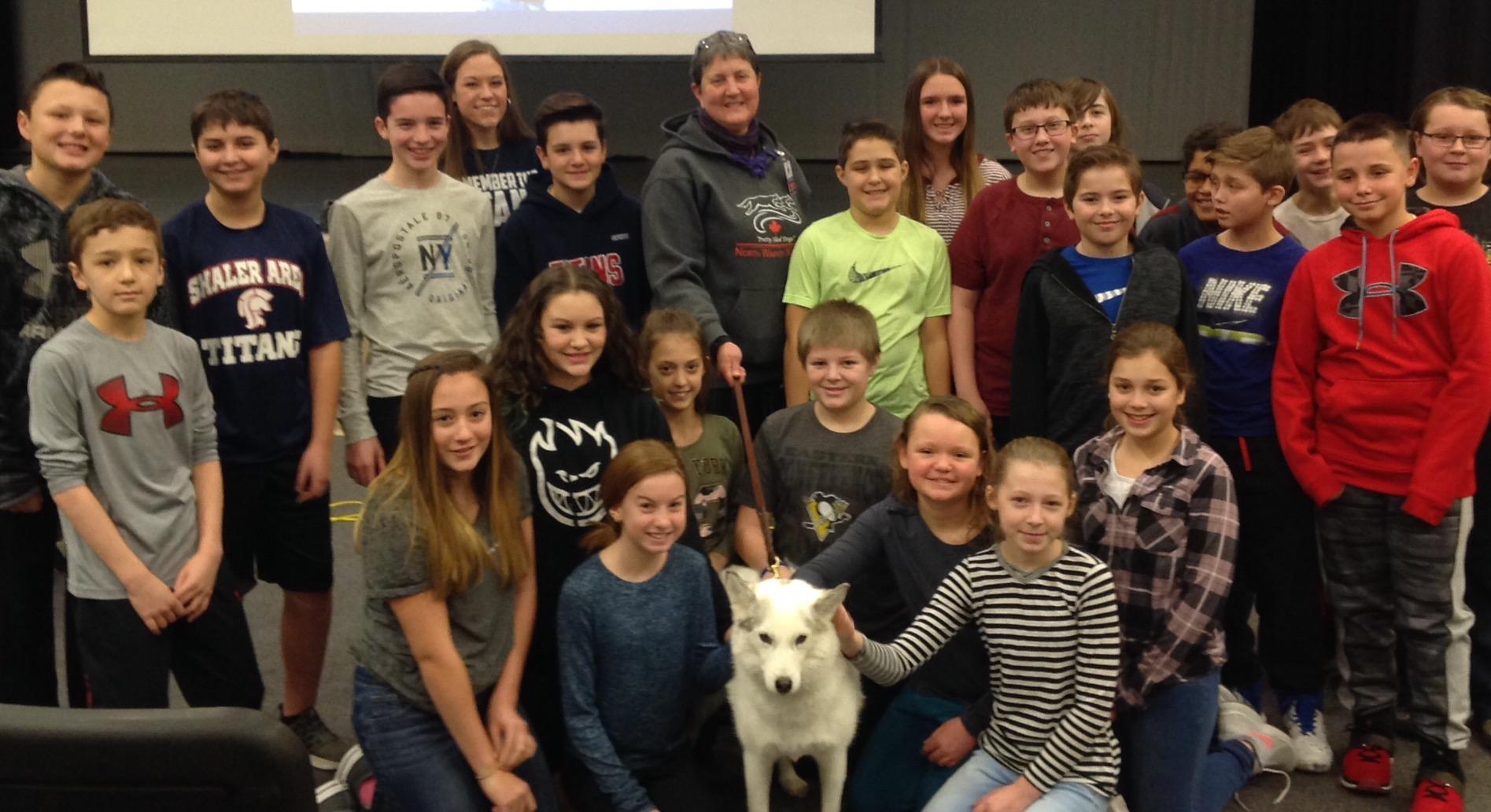 Ms. Kruszewski's 6th Grade ELA Class Posing with a Snow Dog