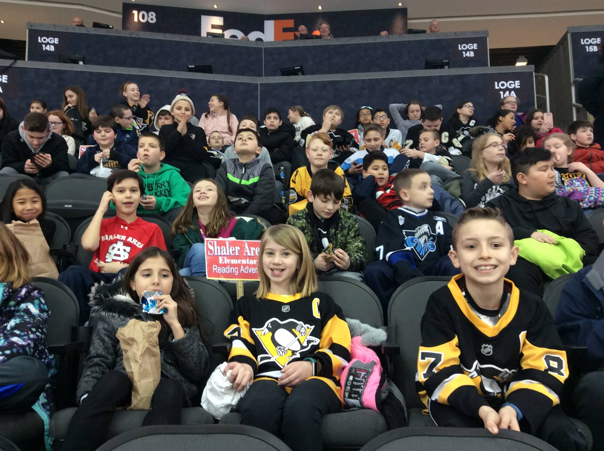Six rows of students sitting at Pens Open Practice at PPG Paints Arena