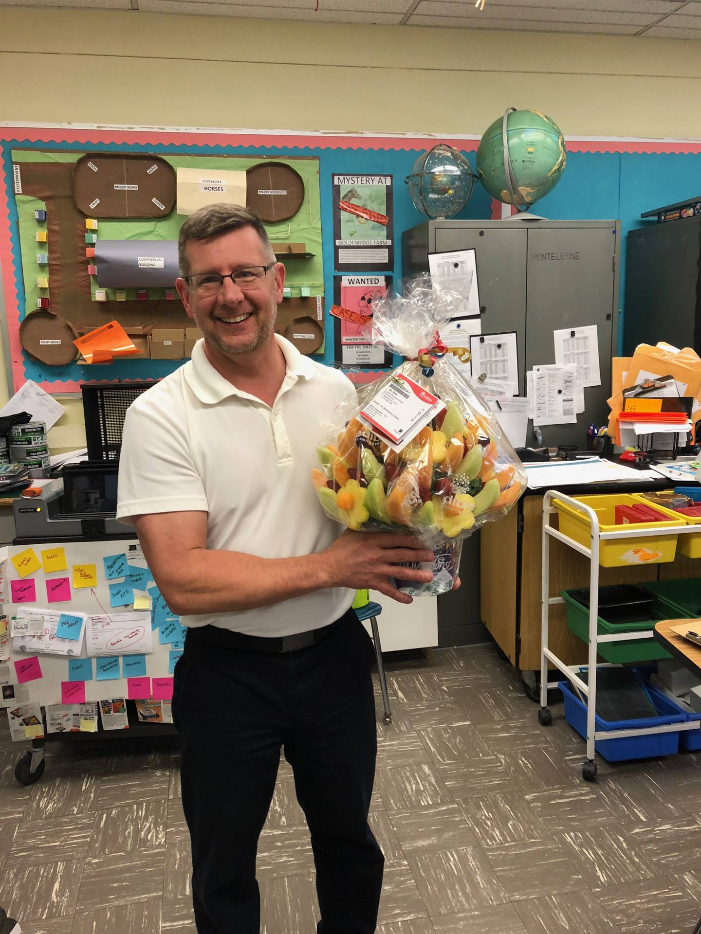Mr. Penn holding Edible Arrangement from his GATE students.