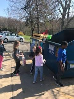 Students throwing trash away