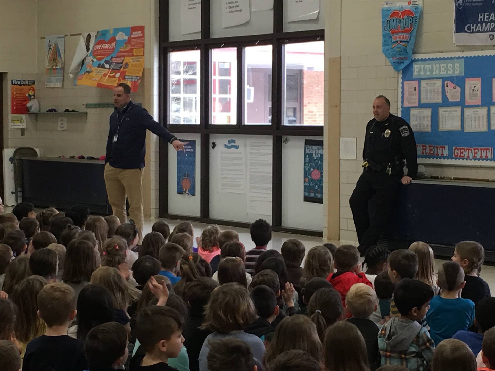 Mr. Rojik and Officer Spiker prepare students for a safety drill