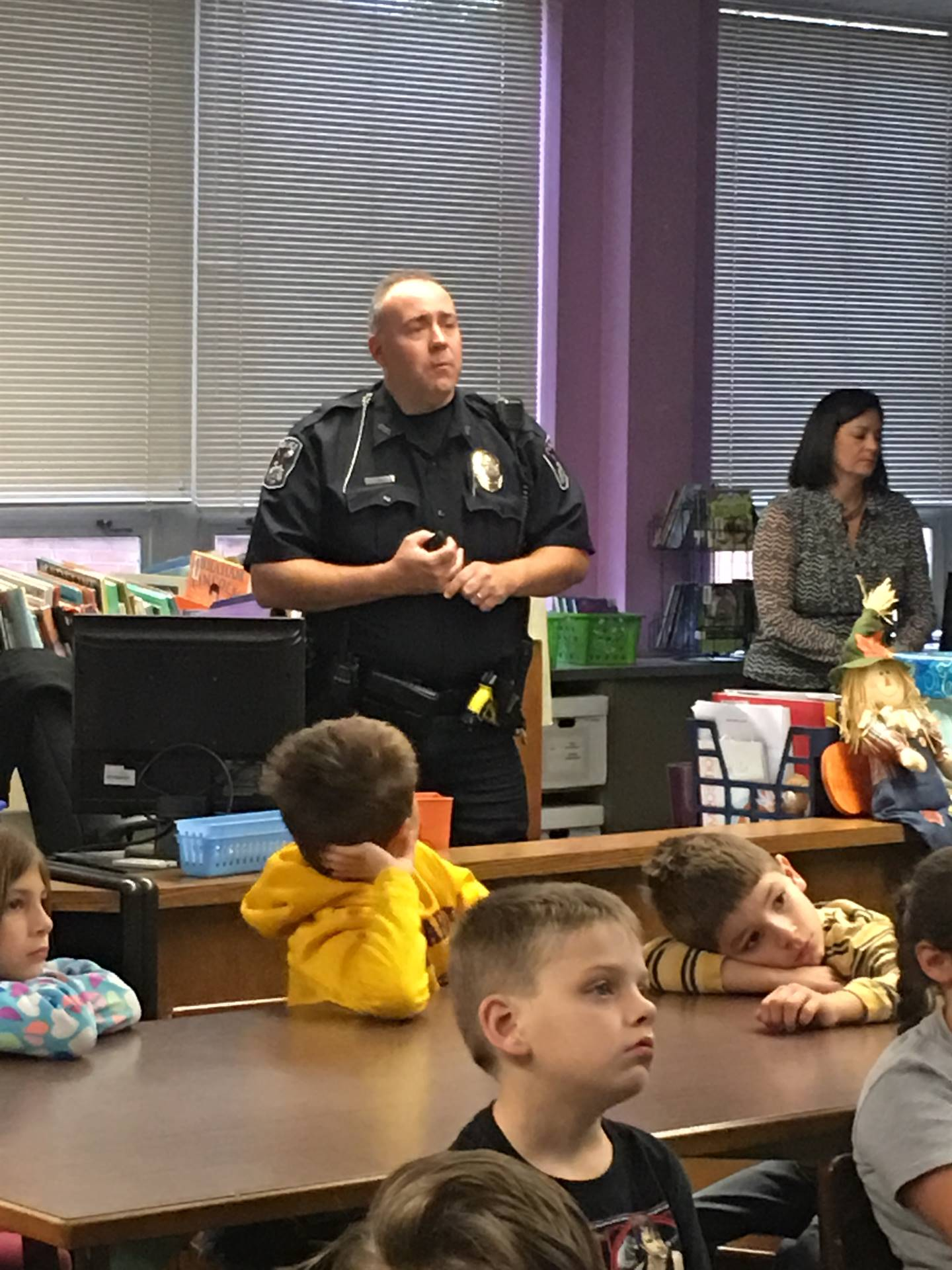 """Officer Spiker talks to students during """"safety day"""""""