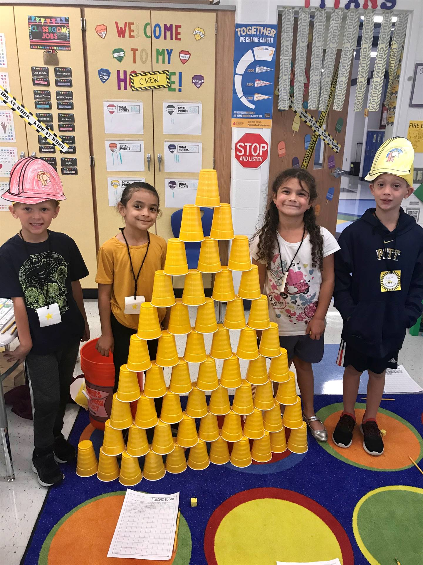 students with cup pyramid