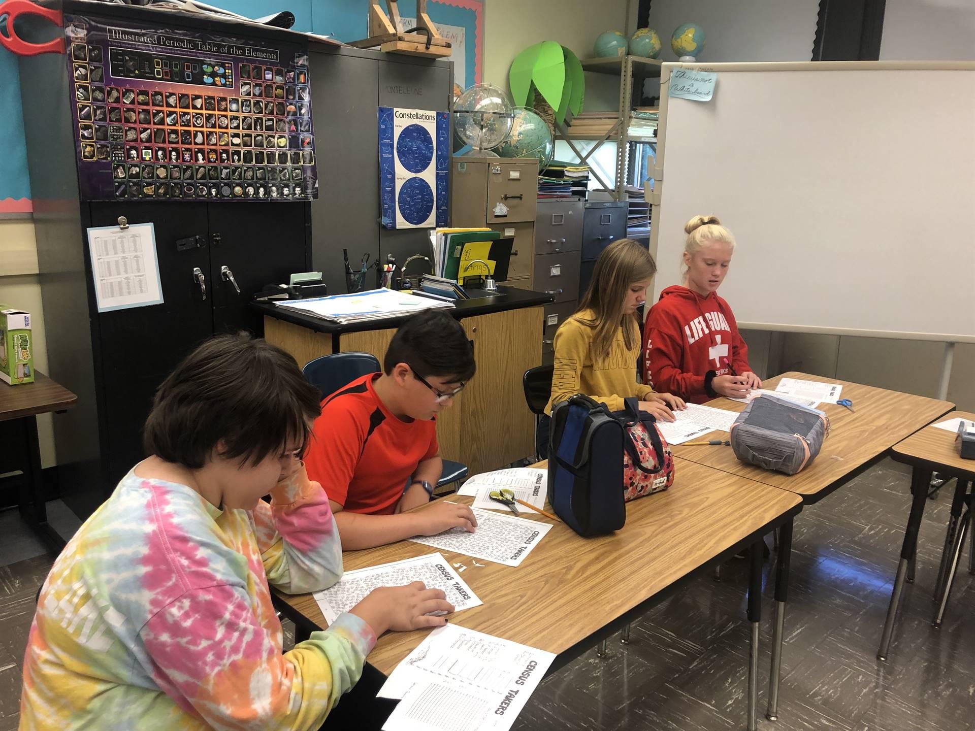 4 students applying strategies in animal sampling activity
