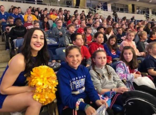 Pitt Cheerleader posing with Students