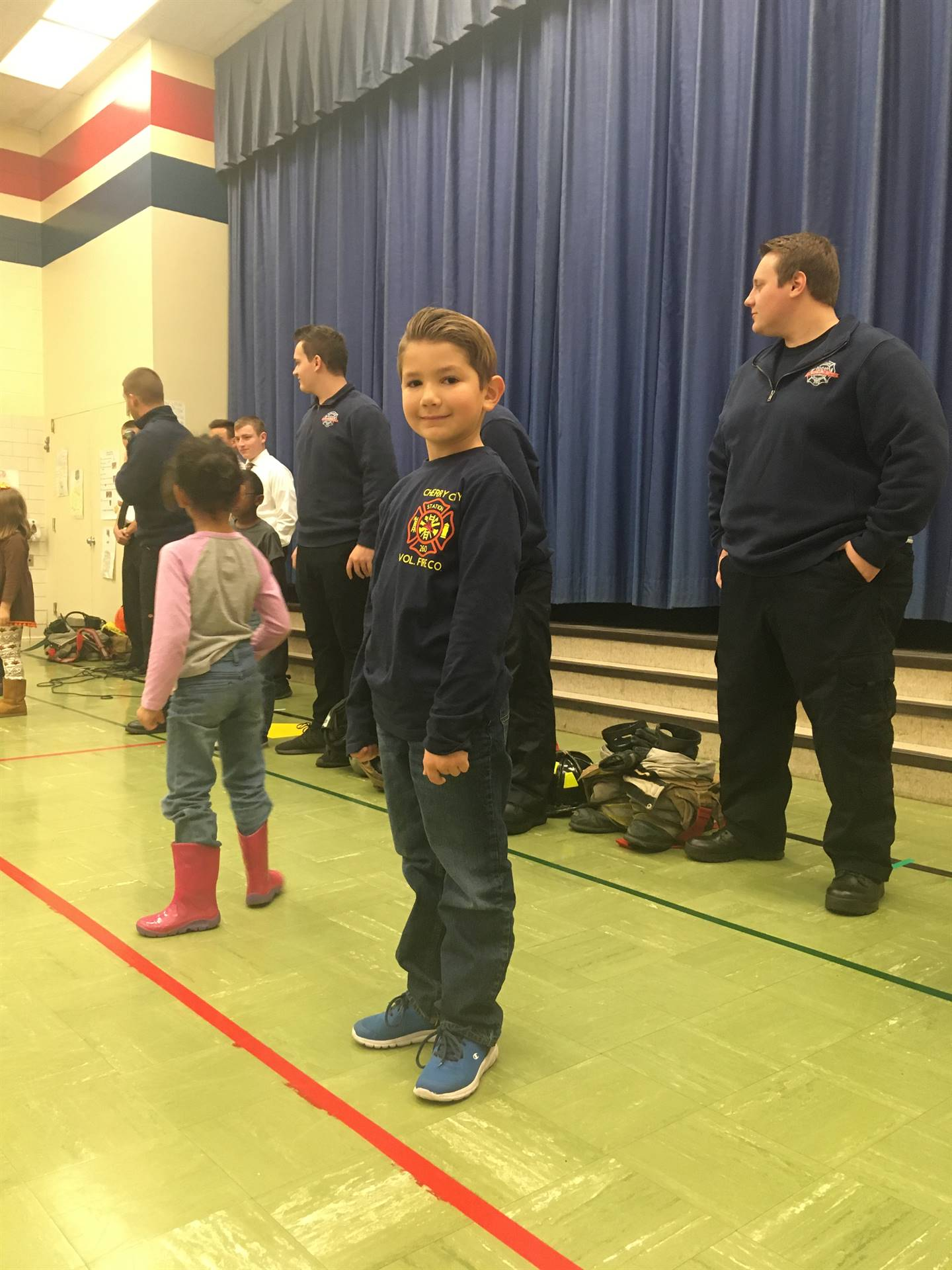 Student on stage during fire prevention assembly