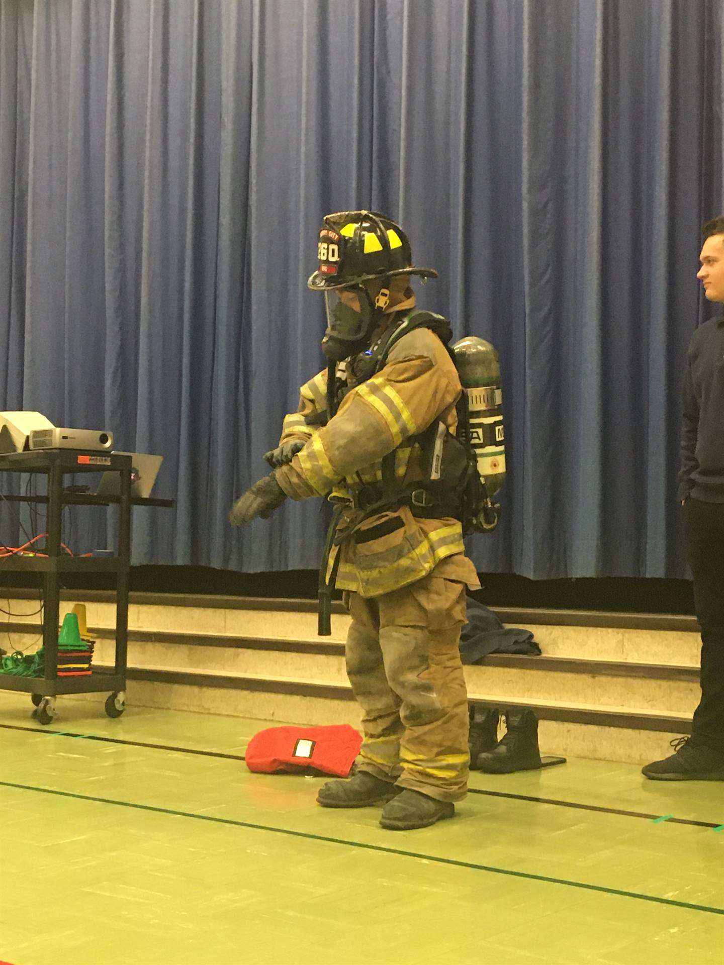 Firefighter puts on fire gear