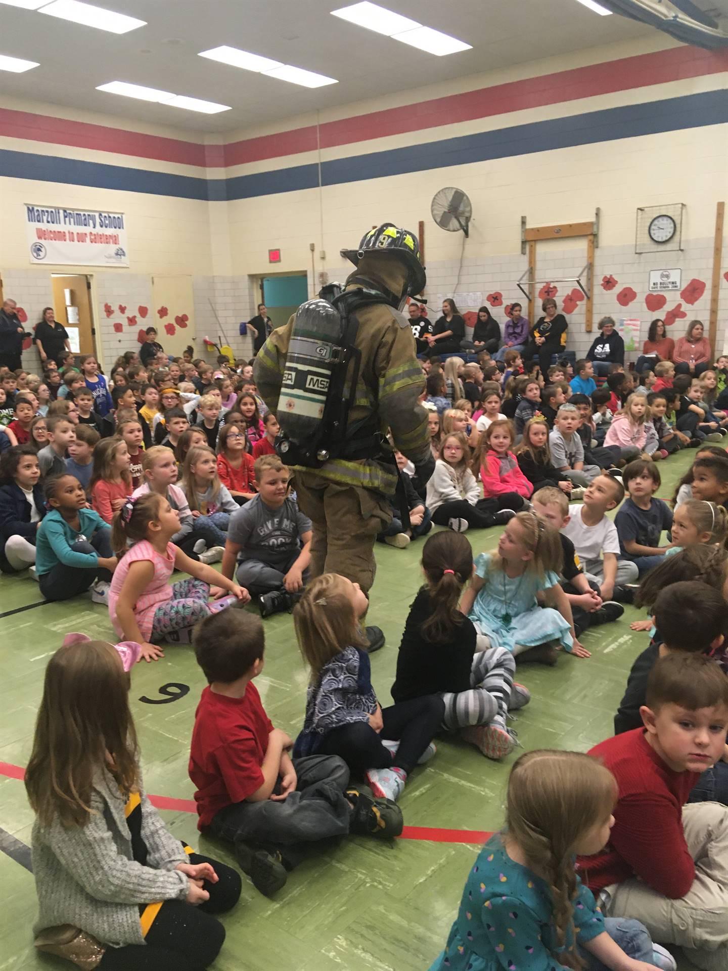 Firefighter showing children gear