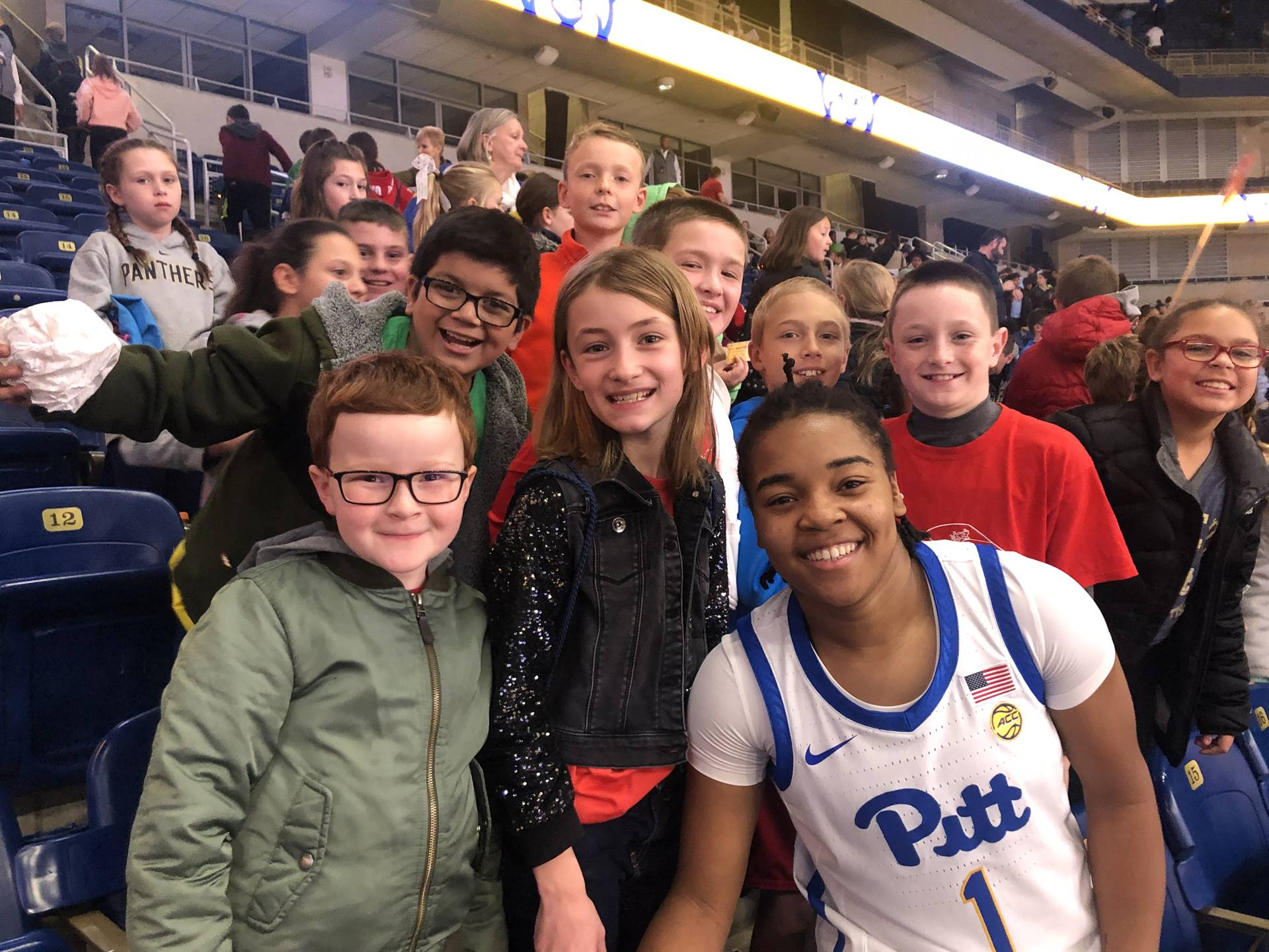 Pitt basketball player with SAES students