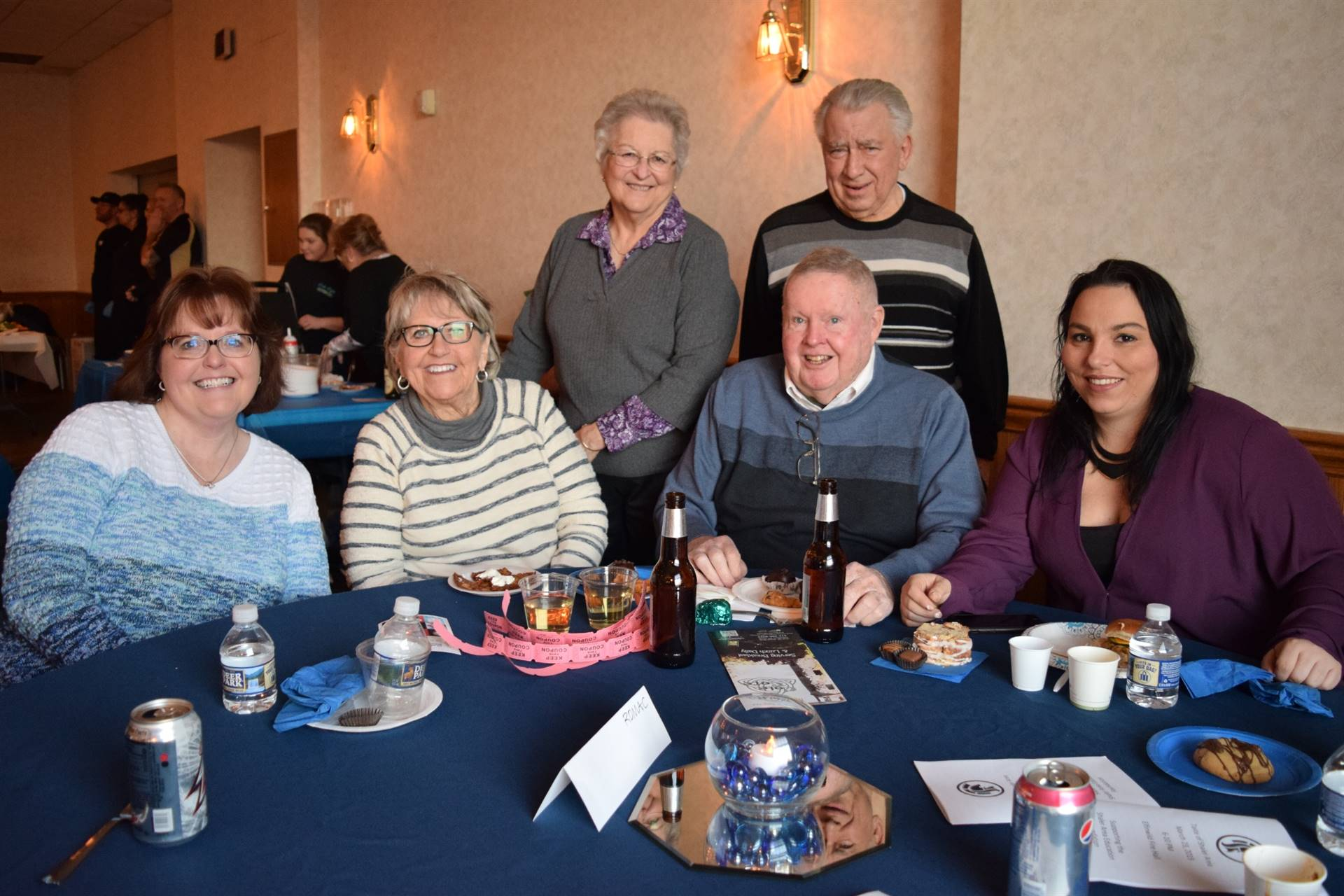 six people posing at a table
