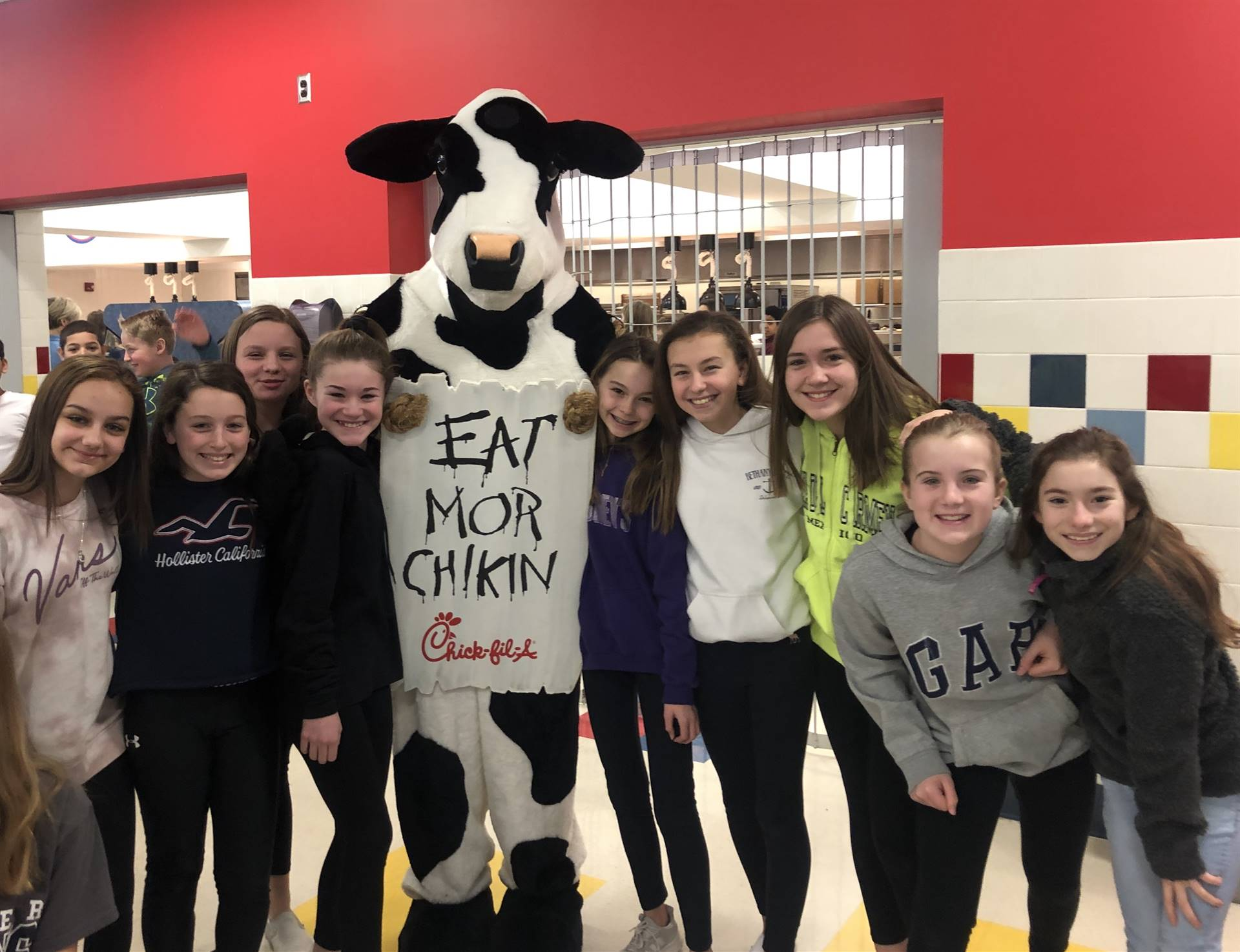 9 6th grade girls with Chick Fil A Cow