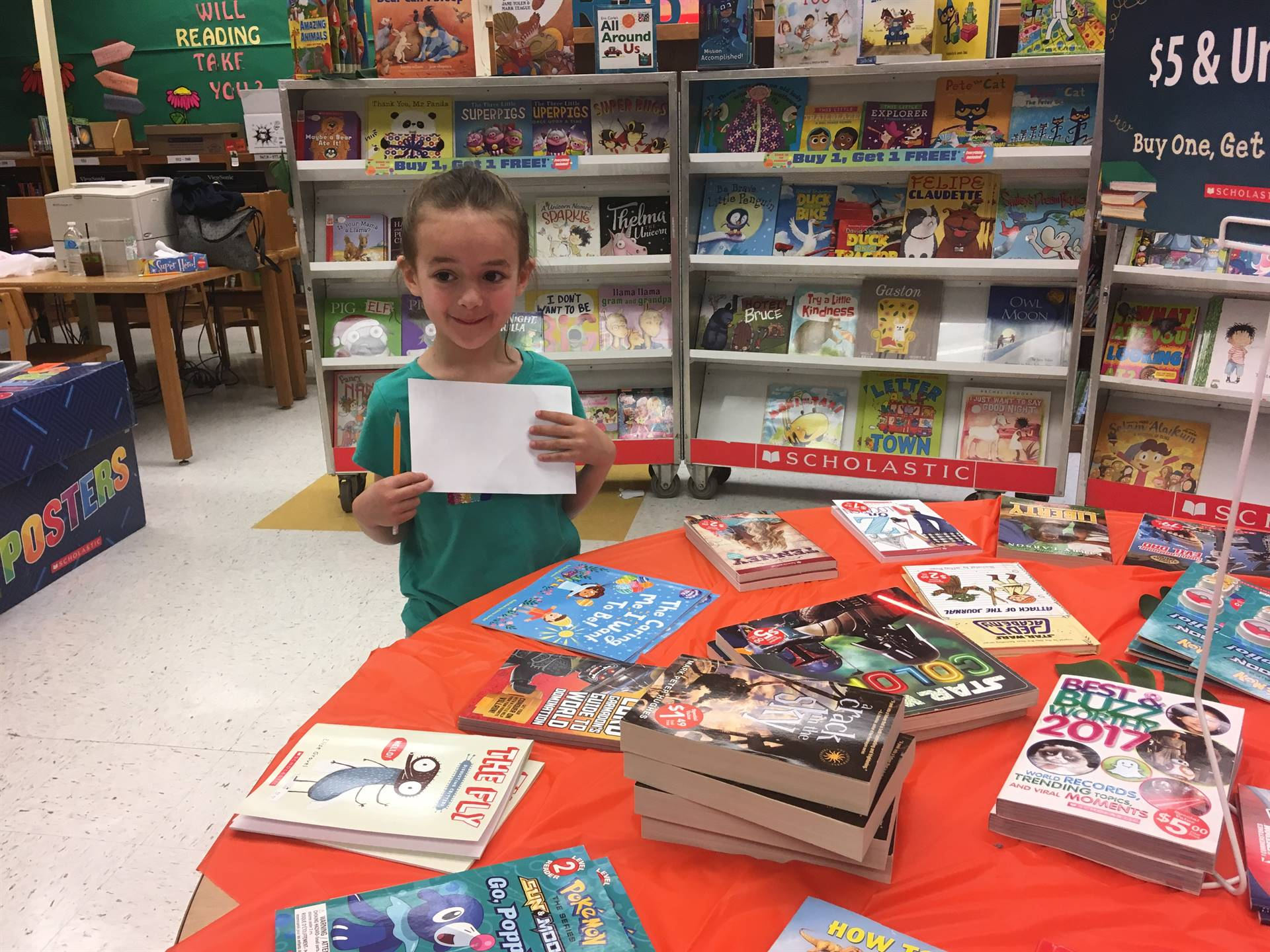student makes wishlist for bookfair