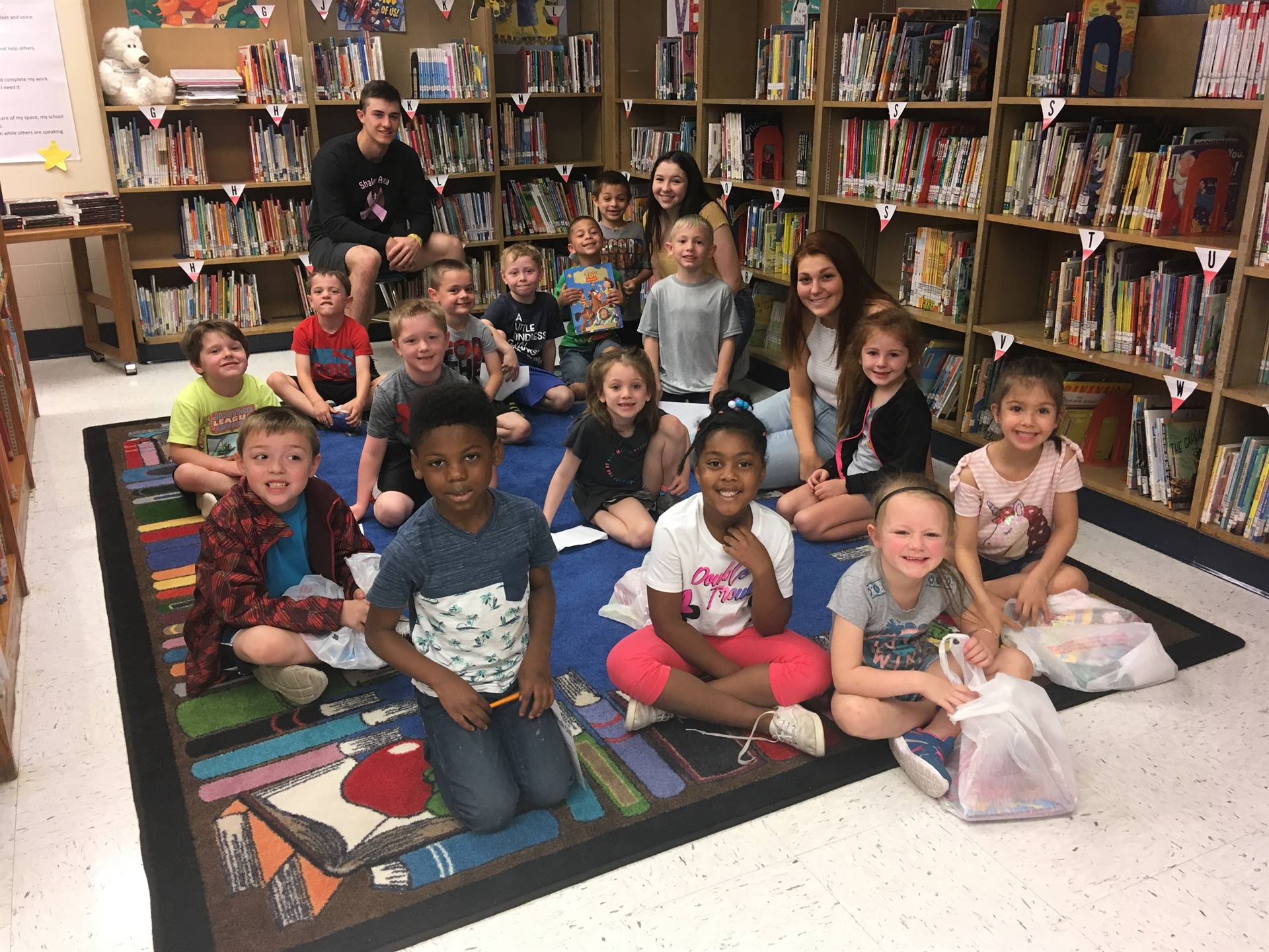 Kindergarten students in library during book fair