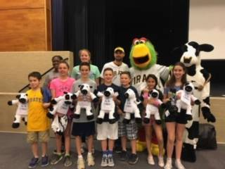 Pirates and Chick fil a Mascots with Group of Students Who Earned Kindness Award