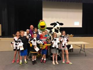 Pirates and Chick fil a Mascots with Group of Students Who Earned Kindness