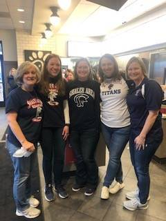 SAES Staff volunteering at Chick fil a Spirit Night.