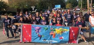 SAES Banner in Homecoming Parade